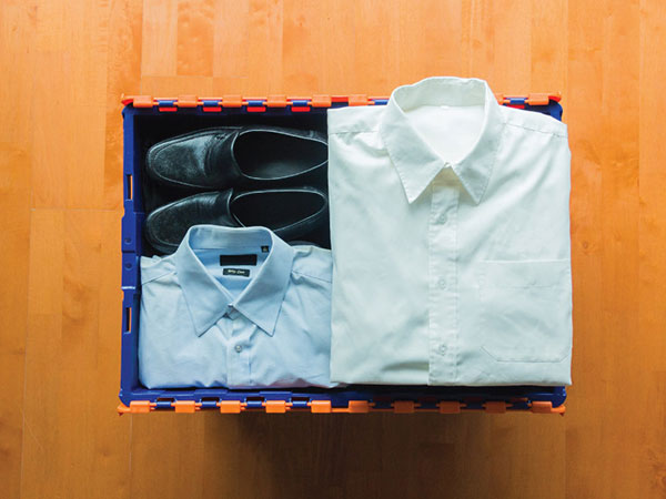 Clothes neatly tucked into a small box