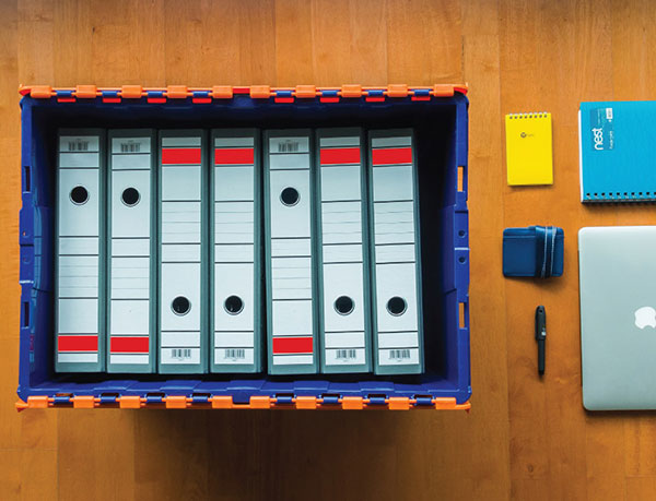 Folders neatly stacked within a box